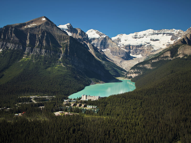 Majestic Canada Rail Vacation through the Rockies | Fairmont Chateau Lake Louise with Victoria Glacier