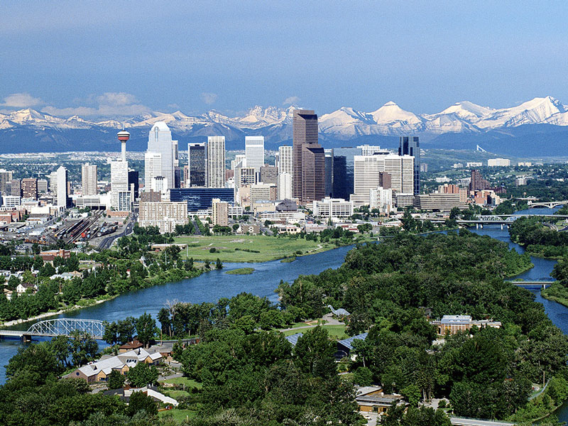 Canada Train Vacations | Calgary with the Rocky Mountains as a backdrop